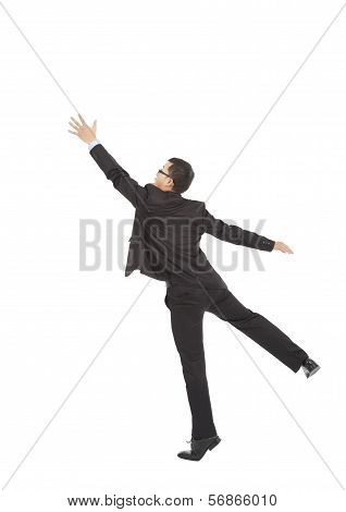 Businessman Jumping And Grabbing Over White Background