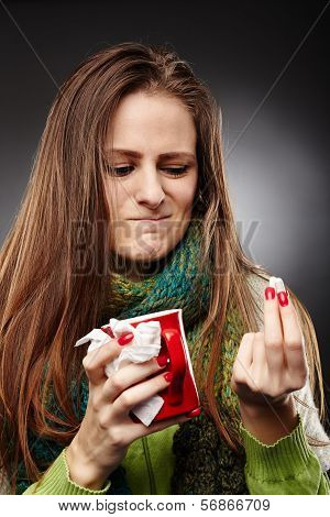 Woman Wrapped Up In A Scarf And Holding A Cup Of Hot Tea Expressing Disgust To Some Drugs She Is Hol