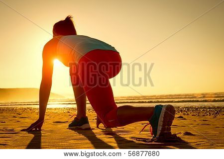 Woman Ready For Running On Beach