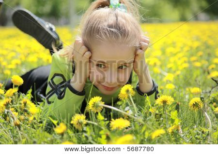 Girl in dandelions