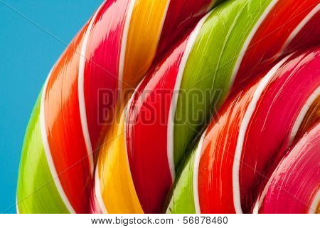 macro of colorful lollipop candy backdrop