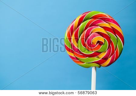 colorful lollipop candy on blue background