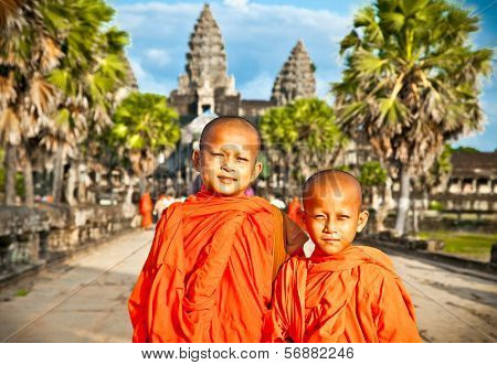 ANGKOR WAT, CAMBODIA - NOV 20,2013: unidentified Buddhist monks in Angkor Wat complex on Nov 20, 2013.Cambodia. Angkor Wat was first a Hindu, then subsequently, a Buddhist temple complex in Cambodia.