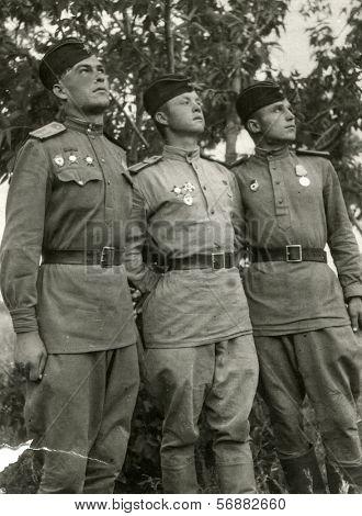 PROCHOROVKA, BELGOROD REGION, USSR, CIRCA 1943: Antique photo, portrait of a three fighter pilot in uniform, circa 1943