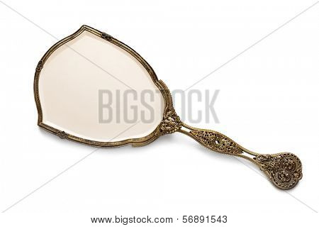 Vintage antique gilded hand mirror, isolated on white background.