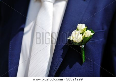 Boutonniere Flower On Jacket Of Wedding Groom