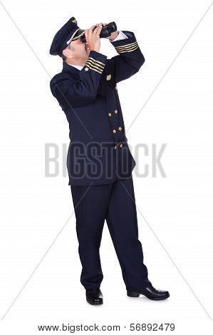 Navigator Looking Through Binoculars
