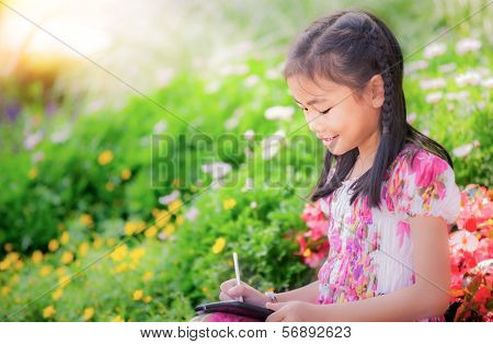Asian Girl Write An Note Pad