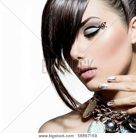 Fashion Model Girl Portrait. Trendy Hair Style. Short Haircut. Hairstyle. Beauty Woman closeup. Fringe. Hairdressing. Silver Metallic Accessories and Manicure. Beauty Woman close up. Perfect Skin