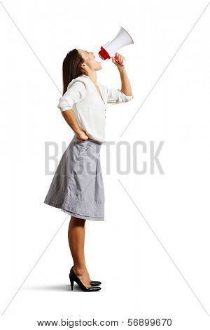 young woman looking up and shouting in megaphone. isolated on white background