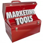 Постер, плакат: Marketing Skills words in a red metal toolbox to illustrate knowledge and talent in business for att