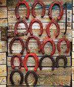 stock photo of talisman  - Painted old horseshoes - JPG