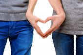picture of two hearts  - Valentine Couple in love showing Heart with their fingers - JPG