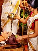 pic of ayurveda  - Young woman having oil Ayurveda spa treatment - JPG