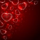 image of soapy  - Valentines background with Hearts from soap bubbles in corner on red background - JPG