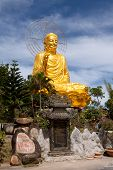 stock photo of lats  - Golden Buddha holding the golden lotus at the Zen Buddhist temple Van Hanh in Da Lat - JPG