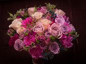 foto of carnation  - Violette palette rose and carnation wedding bouquet on dark background - JPG