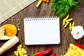 Chilli pepper macaroni herbs and splices on kitchen table poster