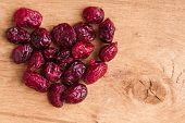 Diet Healthy Food. Heap Of Dried Cranberries On Wooden Background