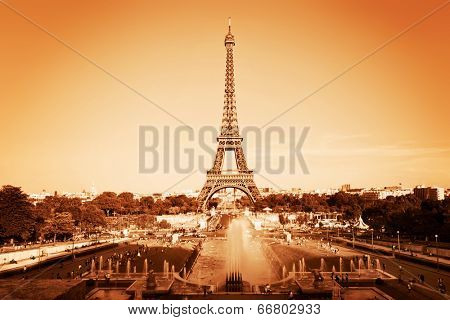 Eiffel Tower seen from fountain at Jardins du Trocadero, Paris, France. Vintage, monochrome gold