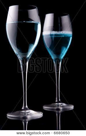 Wine glass with blue liquid