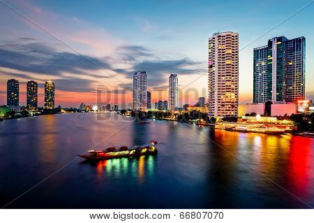 Bangkok Transportation At Dusk With Building Along The River