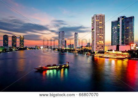 Bangkok Transportation At Dusk With Building Along The River