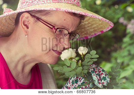 Mature Woman And White Rose