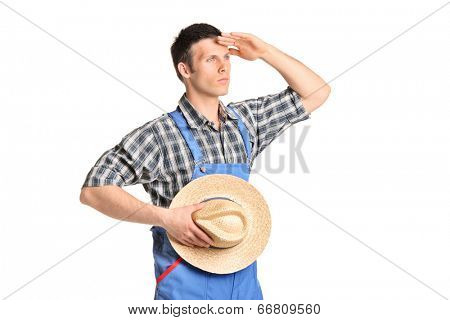 Male farmer in jumpsuit looking in the distance isolated on white background