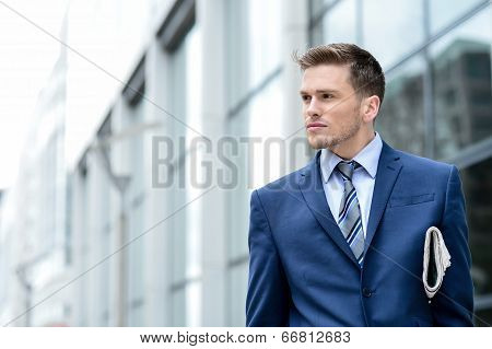 Successful Businessman Holding Newspaper