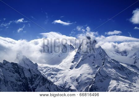 Snowy Mountains In Sunlight Clouds