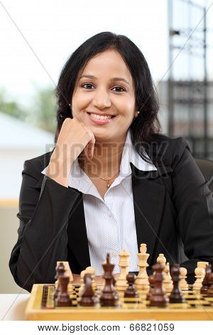 Business Woman With Chessboard And Pieces