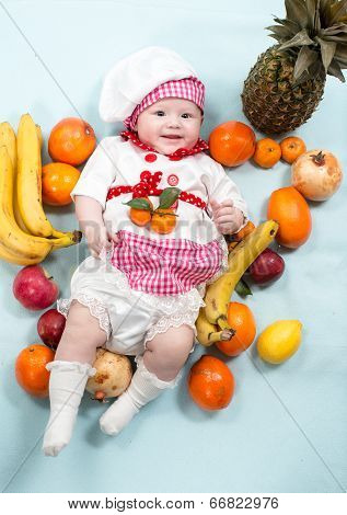 Baby Cook Girl Wearing Chef Hat With Fresh Fruits. Use It For A Child, Healthy Food Concept