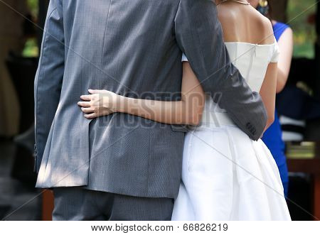 Newlywed Put Their Arms Around Each Others Waist
