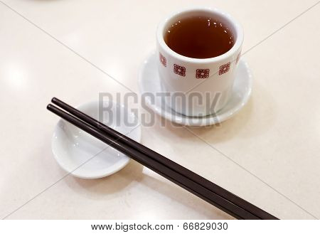 Chinese Tea With A Pair Of Chopsticks