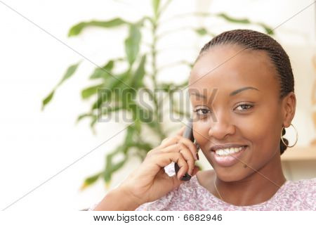 Picture Of A Happy Woman On The Phone