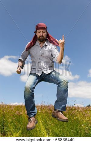 Man With Bandana Forms The Devils Hand