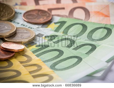 Euro coins and banknotes, macro photo.