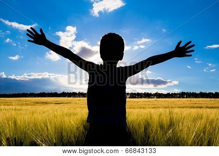 silhouette of kid in the field