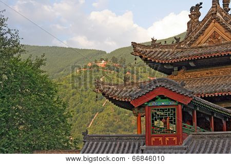 He Roof Of Chinese Temple With Mountains In Background