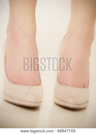 Closeup Of Female Feet In Beige High Heels.