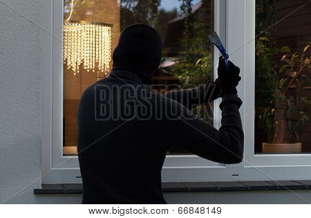 The Burglar Trying To Break