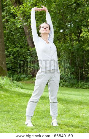 Woman During Practising In Garden
