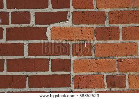 Brick Wall With Nail