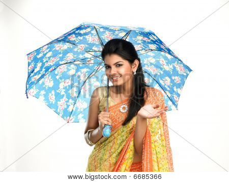 Asian woman under blue umbrella