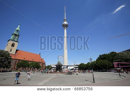 BERLIN, GERMANY - JUNE 11, 2014: The Fernsehturm television tower in central Berlin, Germany, on Saturday, June 11, 2014