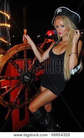 Model poses sexy at Pirates boat