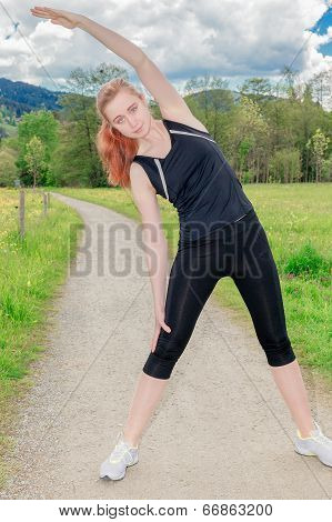 Woman exercising doing side stretches