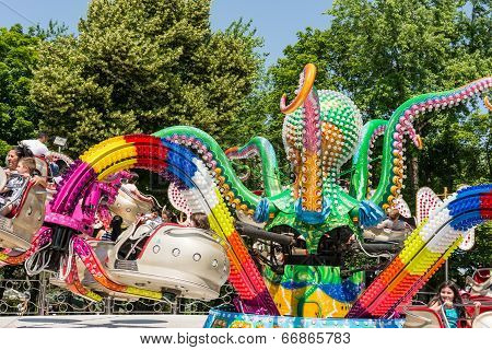 Children Having Fun In Octopus Ride