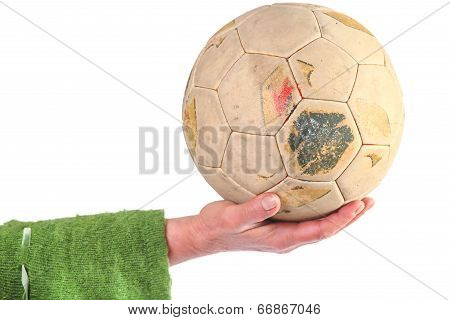 Old Soccer Ball In Women's Hand